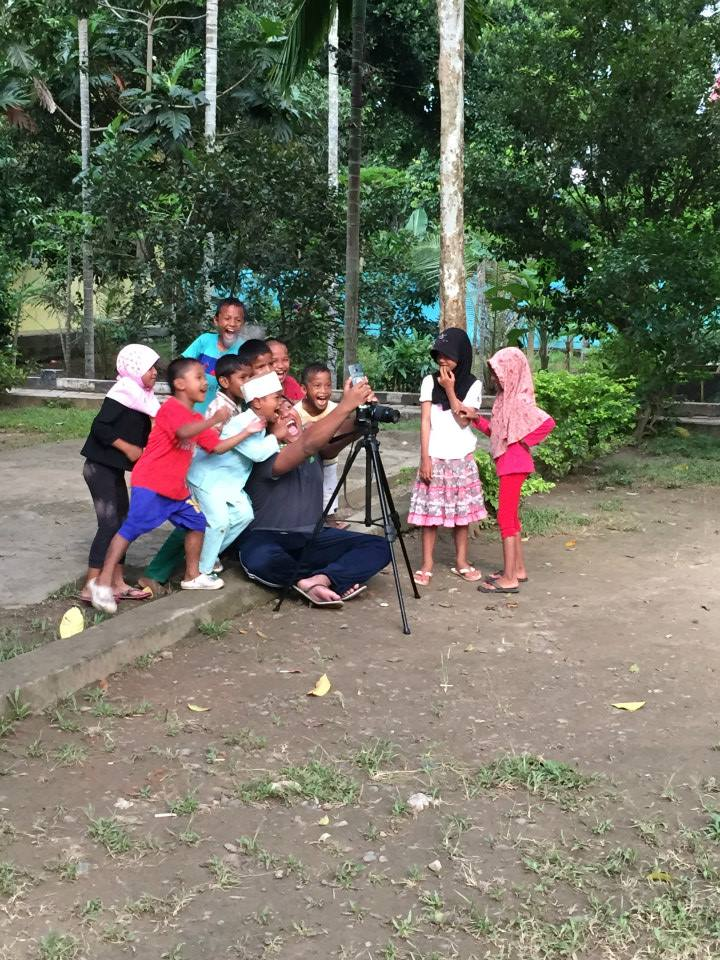 Tsunami affected kids having a light moment with volunteers
